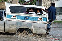 A public transport vehicle sloshes through massive puddles on Gonaives Avenue. Credit: Wadner Pierre