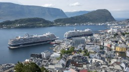 Cruise ships at the port of Aalesund, Norway dwarf many of the city's older buildings. Credit: Trevor Page