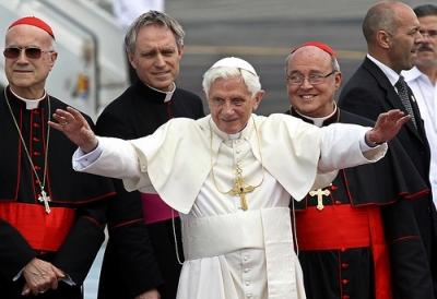 Pope Benedict at Havana airport, flanked by Vatican Secretary of State Tarcisio Bertone (left) and Havana archbishop Jaime Ortega (right). - Jorge Luis Baños/IPS