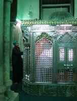 A Sufi follower seeks blessings at the shrine of Sayyida Ruqqaya in Cairo. - Cam McGrath